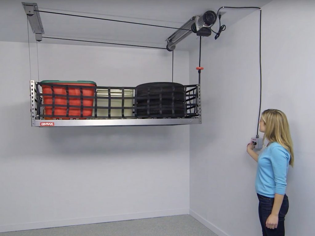 Woman raises her motorized ONRAX storage system in her garage