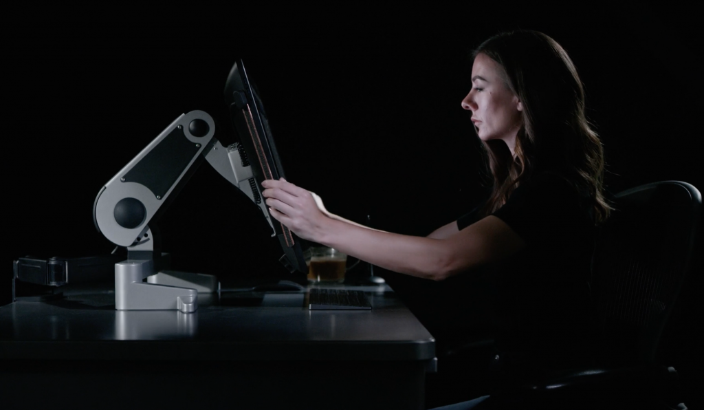Industrial designer moves XOOT position-able computer monitor stand to improve ergonomics