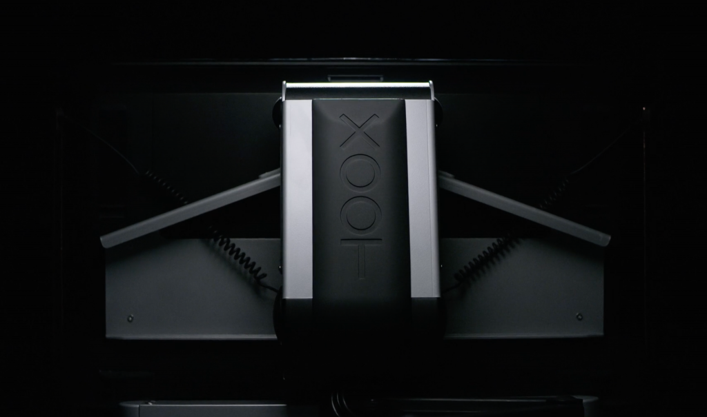 Xoot ergonomic monitor stand in stowed position for better viewing