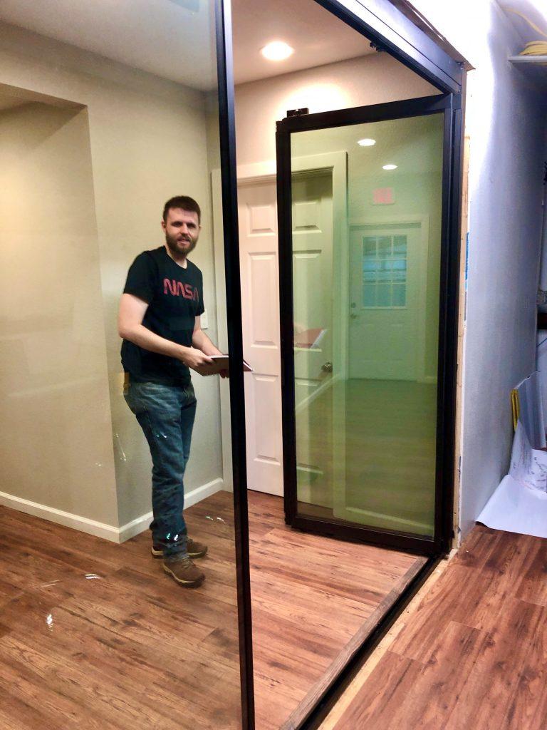 Pillar design engineer understanding the door install process for client Glass Expanse