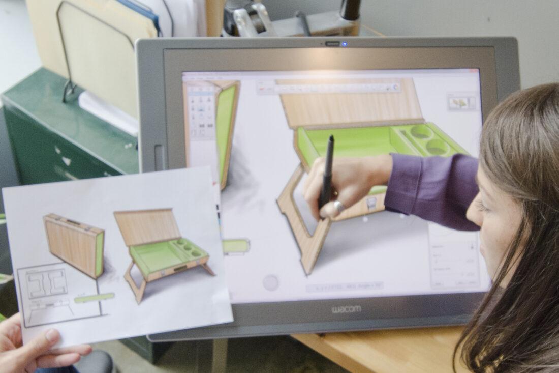 Industrial designer sketches new product idea
